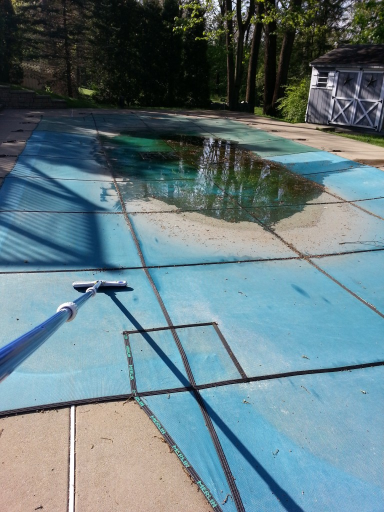 Removing water and debris from cover