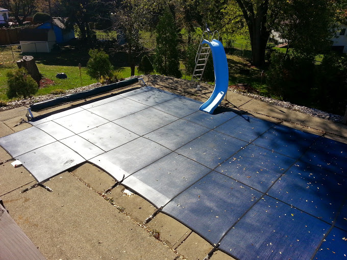 Pool winterized and mesh safety cover installed
