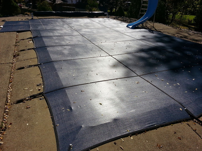 With a mesh safety cover water doesn't collect on the cover meaning leaves and debris blow off over time